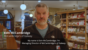 "Same mid-shot of man from earlier example. This time captions are visible and read ""My name is Eoin McCambridge. I'm Managing Director of McCambridge's of Galway."""